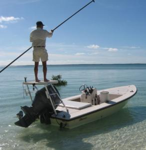 Ricky Sawyer poles from his platform, scanning the shallow Caribbean waters for the elusive silver-gray bonefish.