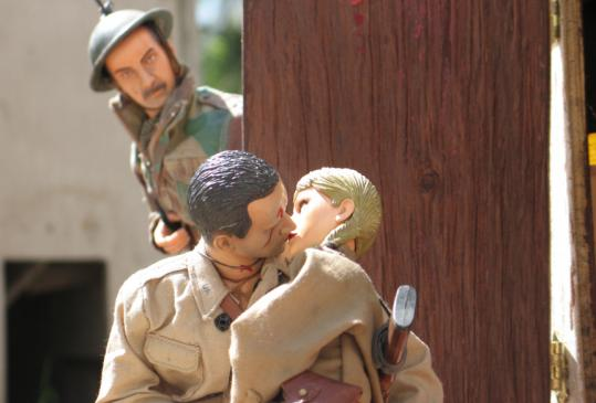 "Hogie and Anna steal a kiss in the documentary ""Marwencol.''"