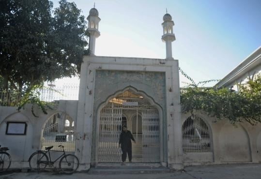 A Pakistani man exited a mosque in Islamabad that was targeted by a would-be suicide bomber yesterday.