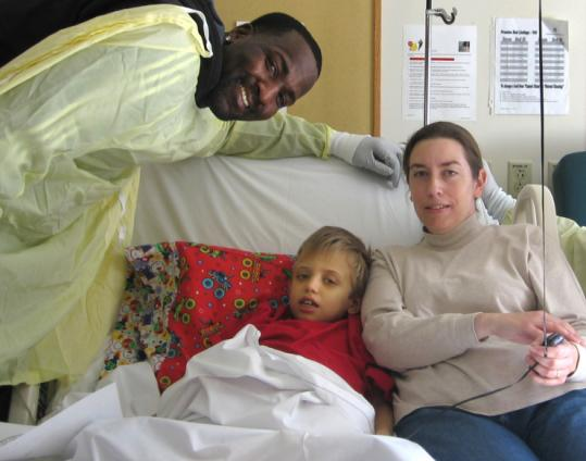Kendrick Perkins dropped in to visit 9-year-old Roger Sarette and Dawn, Roger&#8217;s mom, at Children&#8217;s Hospital Boston.