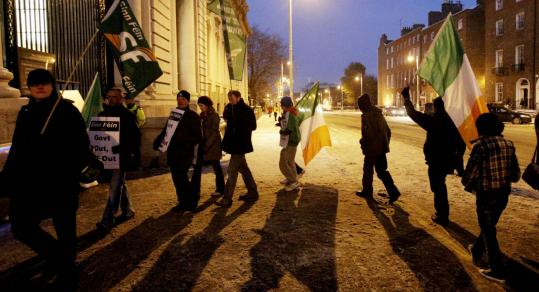 Members of Sinn Fein demonstrated outside government buildings in Dublin yesterday as they waited for details of the bailout.