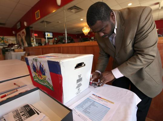 Brockton resident Jules César was one of many local Haitians who symbolically voted at a Dorchester restaurant.
