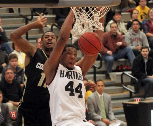 Harvard's Keith Wright jams home 2 of his 19 points against Colorado at Lavietes Pavilion. He also added nine rebounds.