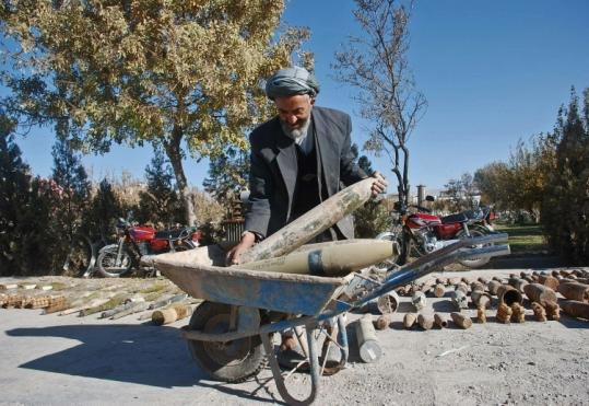 A government worker moved missiles seized after an operation by Afghan security forces in Herat Province.