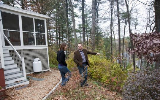 Kelly Mitchell and Adam Waitkunas tour a Weston property.