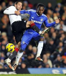 Clint Dempsey (left) fights for the ball with Chelsea's Ghanaian midfielder Michael Essien during an English Premier League match.