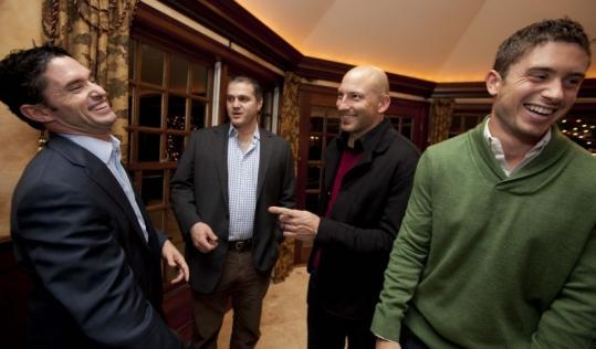 From left: Revolution TV personnel Jay Heaps and Brad Feldman and players Matt Reis and Chris Tierney at the soccer fund-raiser.