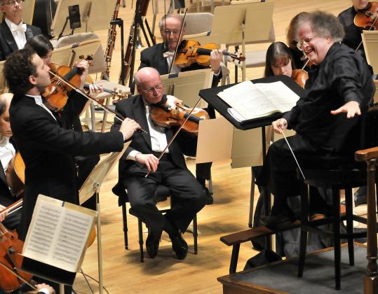 Violinist Nikolaj Znaider (left), with conductor James Levine, performing Mozart's Violin Concerto No. 3 with the Boston Symphony Orchestra on Thursday night.