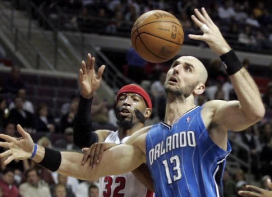 Marcin Gortat (right) stepped up for the Magic, which lost four players to illness.