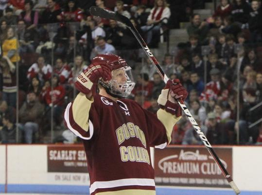BC defenseman Philip Samuelsson raises his stick in celebration after scoring on a blast from the right point in the second period.