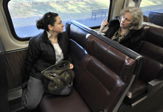 Commuter rail riders such as Jenn Drouin (left) and Rebecca Cutting will soon be able to choose to ride in silence.