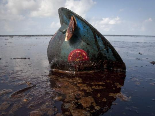 A hard hat from an oil worker lies in oil from the BP spill on East Grand Terre Island, Louisiana, in June.