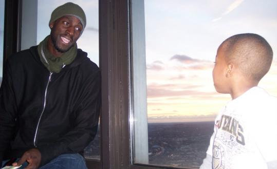 Kevin Garnett and 7-year-old Frankie at the Top of the Hub party.