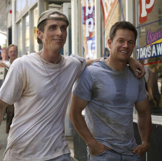 "Christian Bale (as Dickie Eklund) and Mark Wahlberg (as Micky Ward) star in ""The Fighter."""