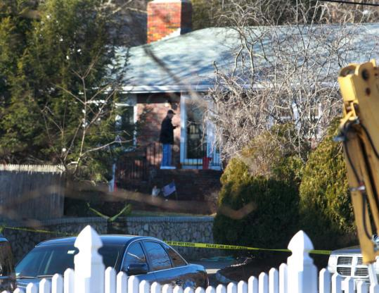 Investigators yesterday searched for evidence at 2 Carmichael Circle in Dedham following the triple shooting that left two family members dead and one critically hurt.