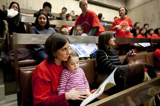 Many on hand yesterday at Boston City Hall, including Sunny Schwartz (with her daughter Ilana), wore red shirts in support of the proposed Boston Chinese Immersion Charter School.