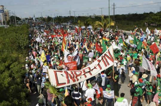 Protesters marched near the site of UN climate change negotiations yesterday in Cancun.