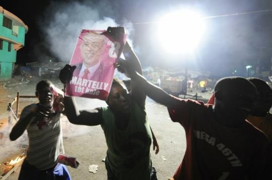 Supporters of carnival singer Michel Martelly protested in Port-au-Prince when results were announced yesterday.
