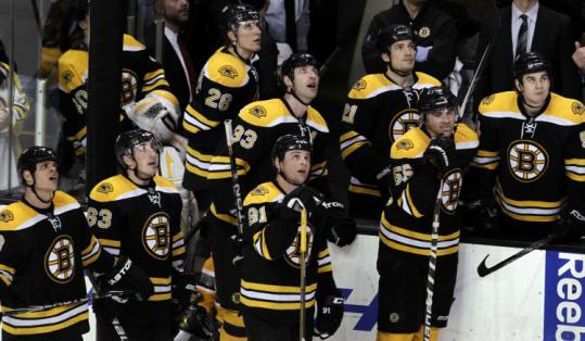 Blake Wheeler (26) and his Bruins teammates watched replays of Mark Recchi's overtime winner as it was reviewed.