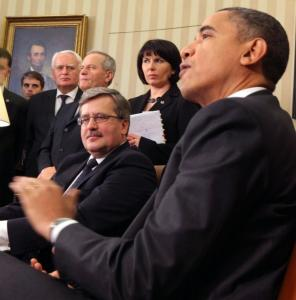 President Obama met yesterday with Poland's president, Bronislaw Komorowski (center), who backed New START.