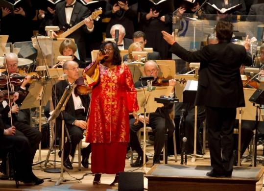 Guest vocalist Renese Kins added her gospel vocals on a trio of Christmas spirituals during the opening night of the Boston Pops' holiday season.