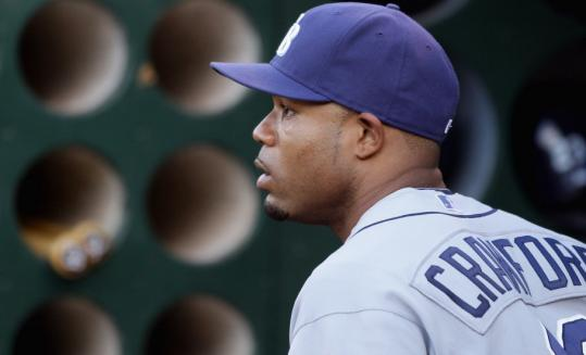 New Red Sox Gold Glove left fielder Carl Crawford is Tampa Bay's career leader in batting average, doubles, triples, stolen bases, and runs.