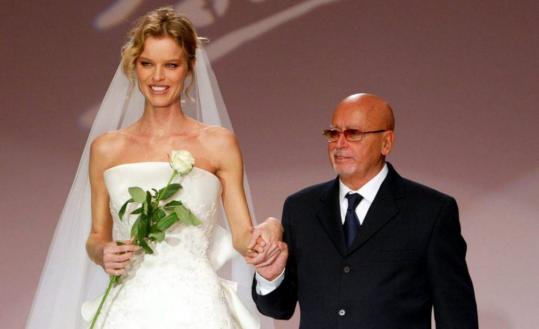 Czech model Eva Herzigova with Italian designer Fausto Sarli at his show in Rome in 2005.