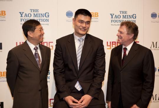 Peter Marzio (right) started a foundation for all-star basketball player Yao Ming (center) as part of a gallery of Chinese art at Museum of Fine Arts, Houston. At left is businessman Jack Zhao.