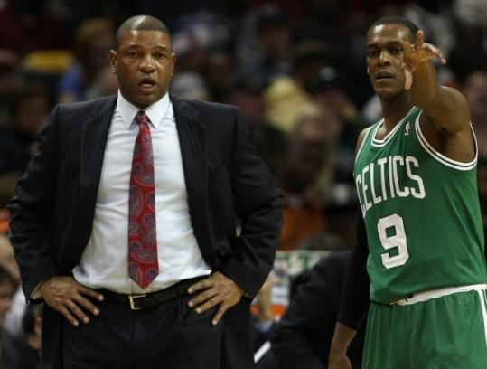 Celtics coach Doc Rivers talks strategy with point guard Rajon Rondo during his team's victory over Charlotte.