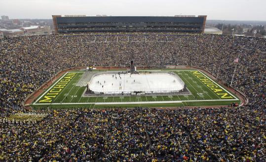 A Michigan Stadium crowd of 113,411 set a world attendance record for a hockey game while watching the Wolverines shut out rival Michigan State.