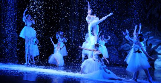"The Snow Queen (Elisabeth Scherer) soars among the Snowflakes in José Mateo Ballet Theatre's ""The Nutcracker'' at the Spingold Theatre in Waltham."