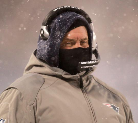 Much like his team, Bill Belichick was prepared for the elements in Chicago. The Patriots coach supplemented his trademark hoodie with something more heavy duty.