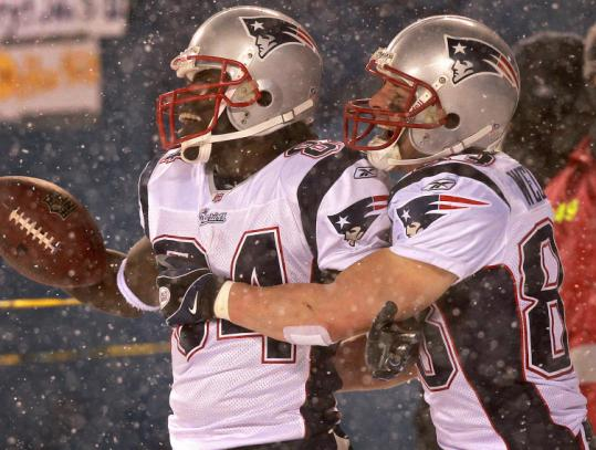 Receiver Deion Branch (left) celebrates with Wes Welker after Branch's touchdown catch with no time left in the first half.