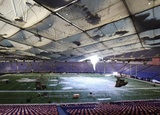 Instead of a football game, the Metrodome tonight will host a cleanup crew to clear out the snow that fell through a tear in the Teflon roof.