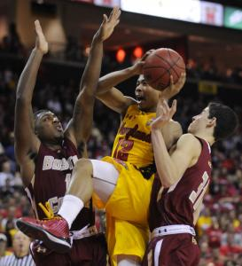 Maryland's Terrell Stoglin splits the defense of Corey Raji (left) and Danny Rubin in the second half.