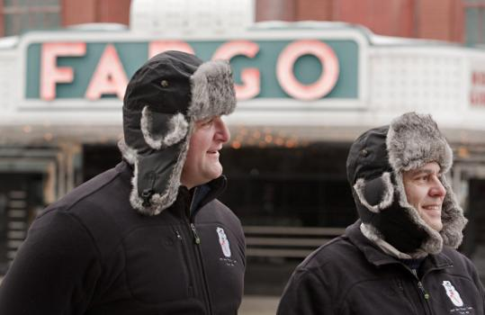 Dave Bayha and Jim Costas said the bomber hats the candy company gave them to wear in Fargo, N.D., are really warm.
