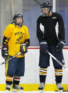 Needham High teammates Timmy Parlato (left) and Chris Joyce compare notes during practice, with the team in agreement on the season's big goal: winning the Super 8 postseason tournament.