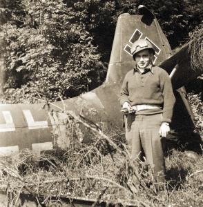 Arnold Weiss near wreckage of a Nazi plane in 1945 in Germany. He became a successful lawyer.
