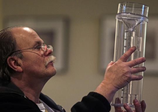 Luke Quigley of Madison, N.H., checked out a rain gauge at a class for volunteer weather observers.