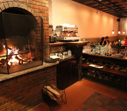 A fireplace adds warmth to the dining area at Bondir, which opened in November.