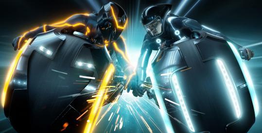 """Sam Flynn (Garrett Hedlund, right) enters his dad's computer world in """"Tron: Legacy.''"""