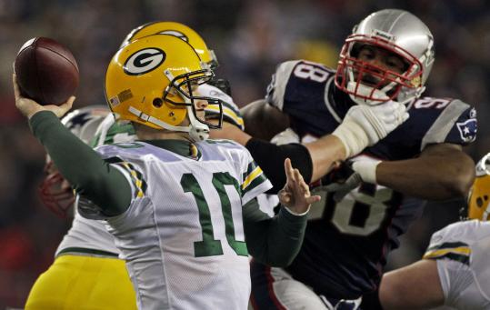 Packers' quarterback Matt Flynn fires the first of his three touchdown passes against the Patriots in his first NFL start. Flynn completed 24 of 37 passes.