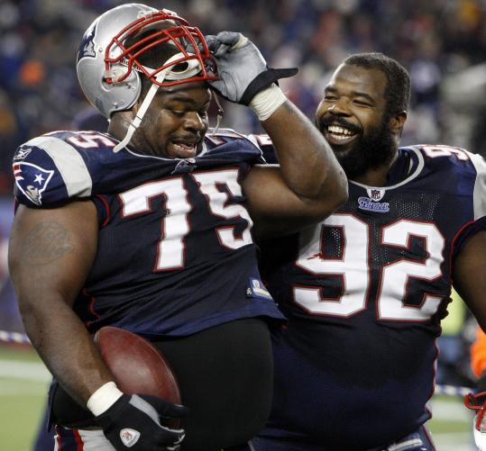 Gerard Warren smiles and Vince Wilfork doesn't want to give up the ball he recovered to end the game.