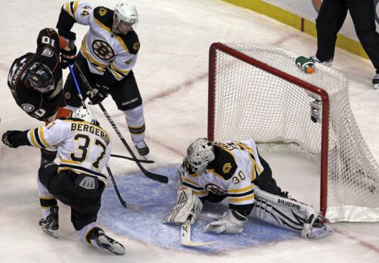 Anaheim's Corey Perry beats Bruins goalie Tim Thomas shorthanded to put the Ducks ahead, 3-0, in the second period.