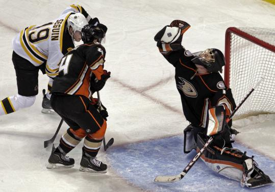 The Ducks&#8217; Jonas Hiller snatches a puck out of midair in the third period as Anaheim&#8217;s Cam Fowler checks Bruin Tyler Seguin.