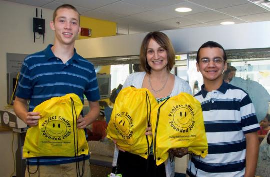 Joey Salmeron (right) at the Jimmy Fund Clinic with friend Alexander Tight (left) and Lisa Scherber of Dana-Farber.