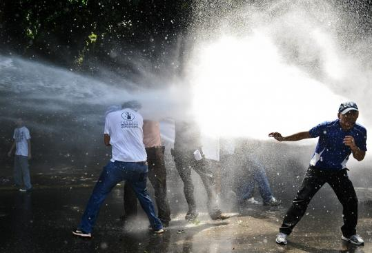 Police used a water cannon against Venezuelan students who oppose a law that increases government control of universities.