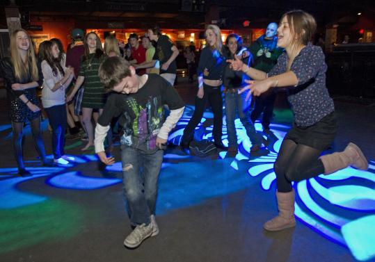 "Maddie Benzer, 18, and Camden Green, 9, danced at the ""Make Noise to Save a Life'' event at the House of Blues last night."