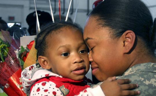 """Mommy is home, mommy is home,"" Ebony Hobson of Fall River told Amieyah, 2, at the Dorchester Armory yesterday."