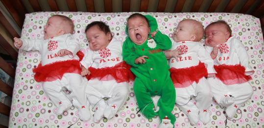 The Spicocchi quintuplets — from left, Ilah, Paige, Enzo, Ellie, and Gia — spent their first Christmas at home yesterday in Massillon, Ohio. The babies were born Aug. 3, about 14 weeks early, with each weighing less than 2 pounds.